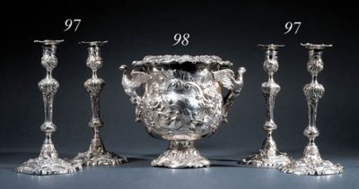 Four Irish silver candlesticks