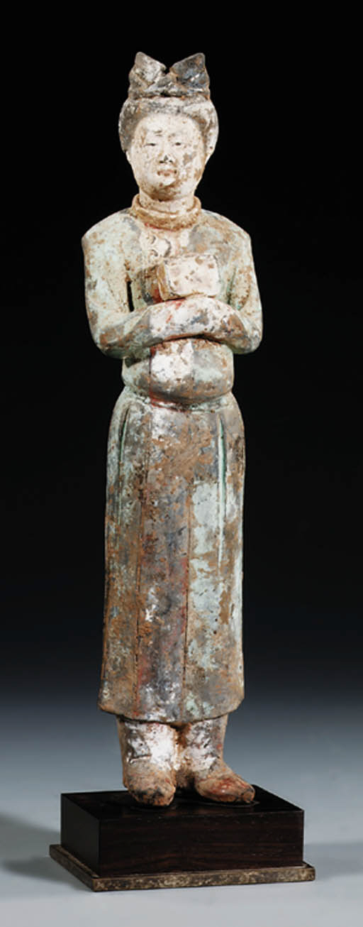 A STANDING FIGURE OF A FEMALE