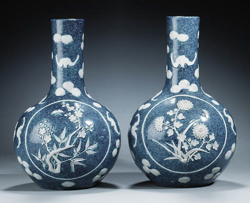 A PAIR OF WHITE-SLIP-DECORATED