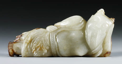 A YELLOW AND RUSSET JADE CARVI