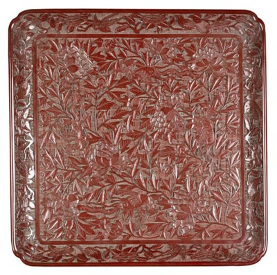 A CARVED RED CINNABAR LACQUER