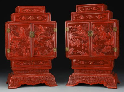 A PAIR OF CARVED CINNABAR LACQ