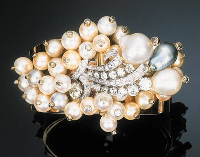A Cultured Pearl and Diamond-s