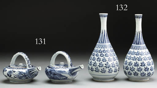 A PAIR OF ARITA TEAPOTS AND CO