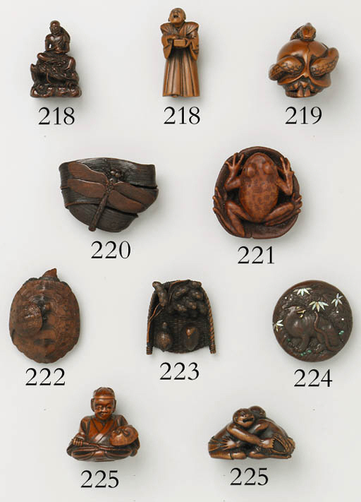 AN INLAID WOOD MANJU NETSUKE
