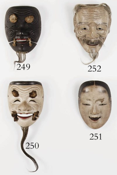 A WOOD MASK OF KOOMOTE