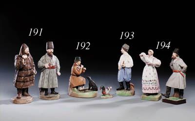 A porcelain Figure of an Ukrai