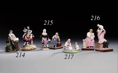 A porcelain Group of a seated
