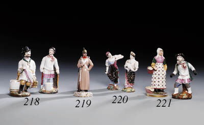 Two glazed porcelain Figures of peasant Women