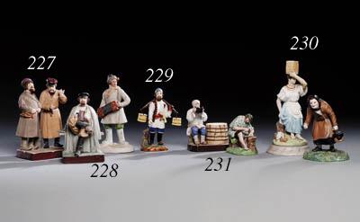 Two porcelain Figures of an yo
