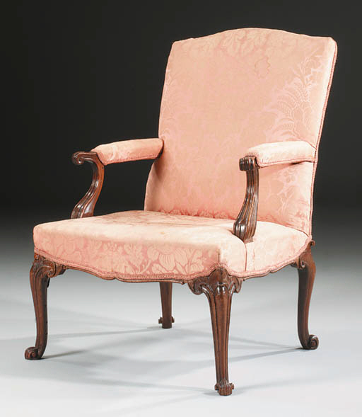 A GEORGE II MAHOGANY LIBRARY OPEN ARMCHAIR