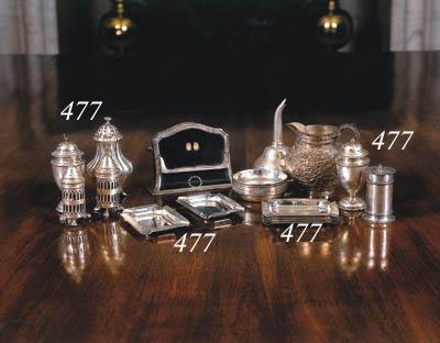 A set of six silver ashtrays
