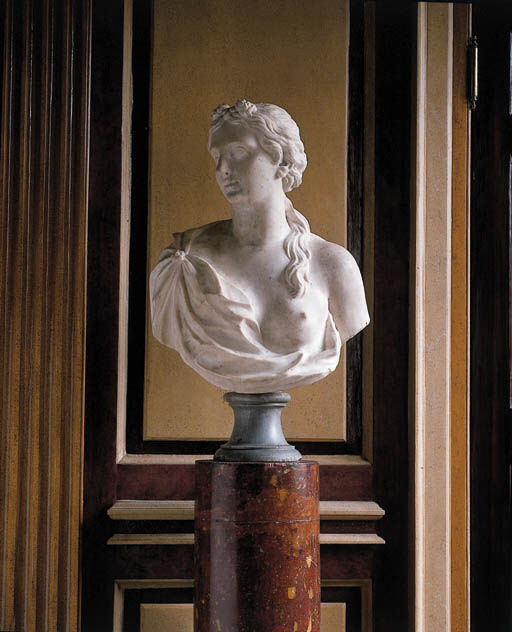 A CARVED MARBLE BUST OF A NYMP