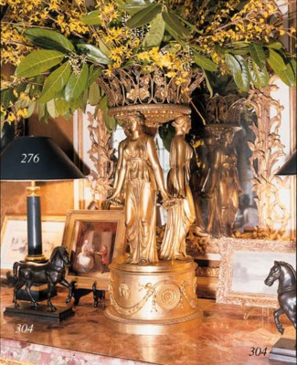 A PAIR OF BRONZED TABLE LAMPS