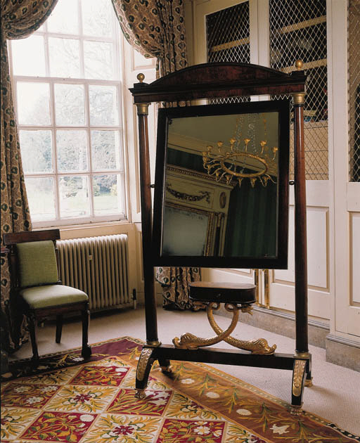 A BALTIC WALNUT AND PARCEL GILT CHEVAL MIRROR