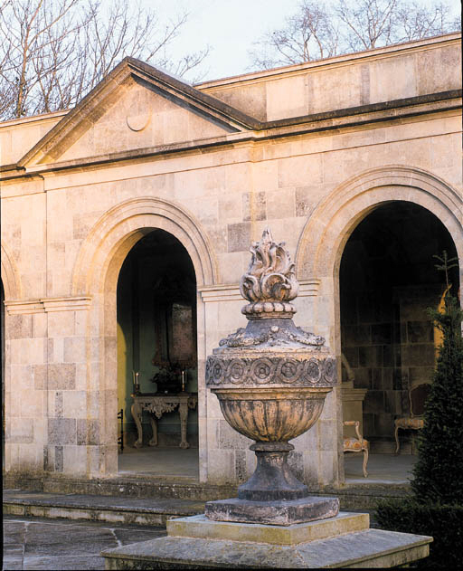 A PAIR OF COMPOSITE STONE URNS