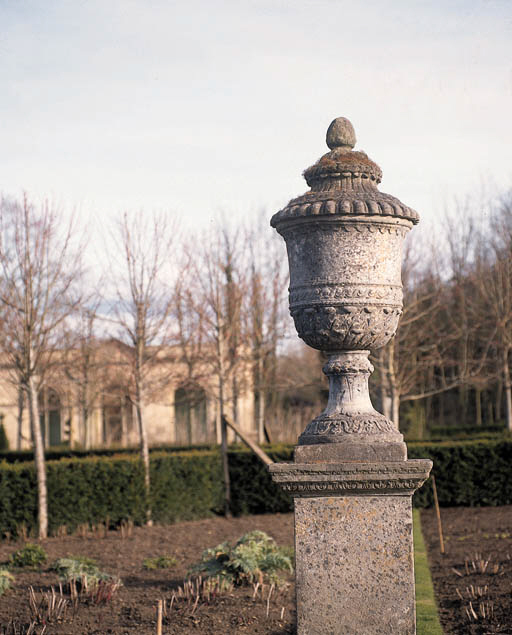 FOUR COMPOSITE STONE URNS
