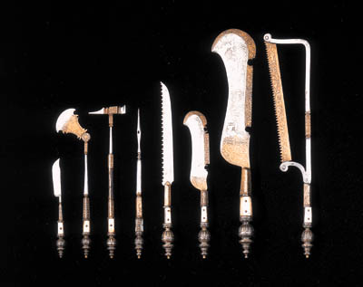 A SET OF EIGHT MOTHER-OF-PEARL AND PARCEL-GILT STEEL SURGEON'S TOOLS