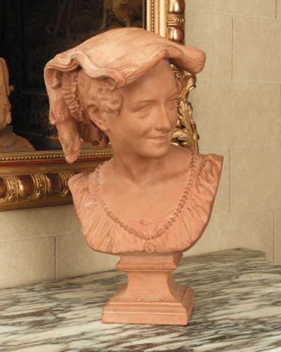 A Napoleon III terracotta bust entitled 'La Rieuse Napolitaine'