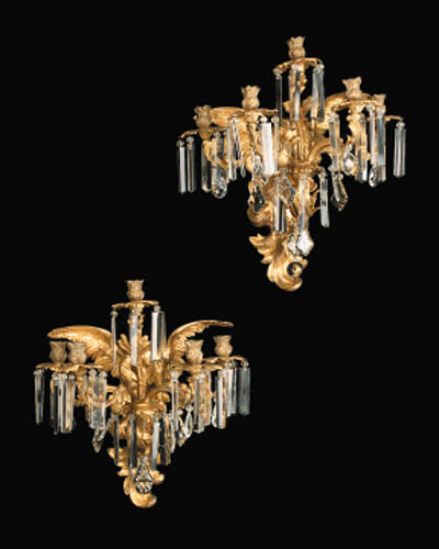 A pair of English Ormolu and moulded-glass five-light wall appliques