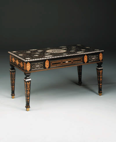 An English ivory, marquetry, ebony and ebonised centre table