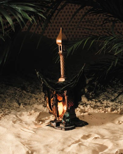 A patinated bronze lamp modell