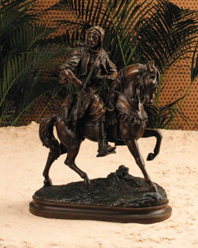 A French painted Spelter equestrian group entitled 'Cavalier Arabe'
