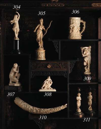 A German carved ivory powder f