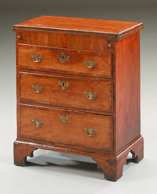 A GEORGE II FRUITWOOD BACHELOR