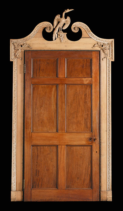 A CARVED PINE DOOR-SURROUND AN