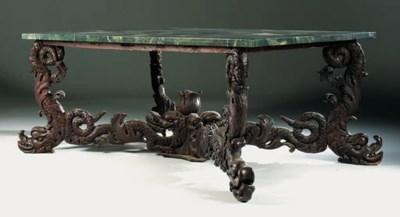 A ROMAN WALNUT CENTRE TABLE