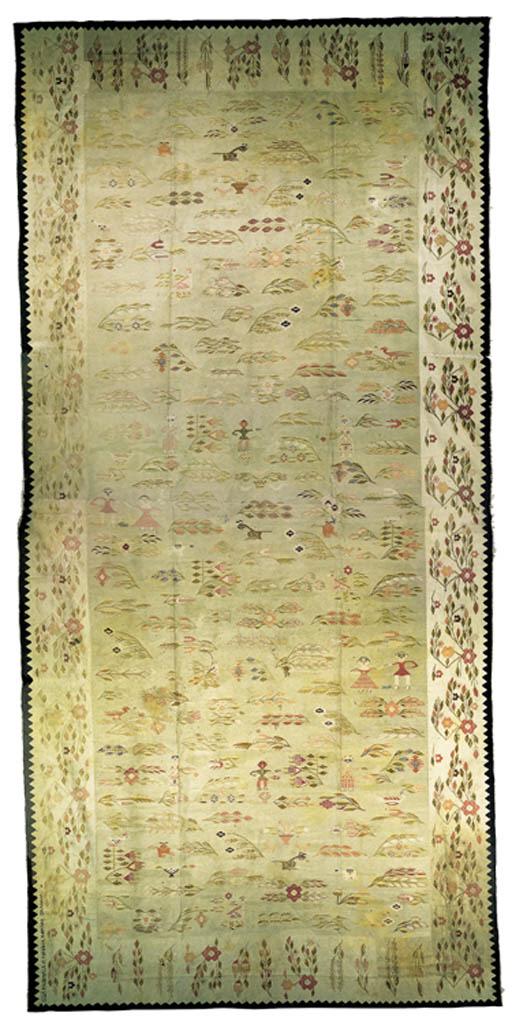 A ROMANIAN FLATWEAVE CARPET