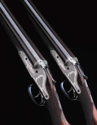 A PAIR OF 12-BORE ASSISTED-OPE
