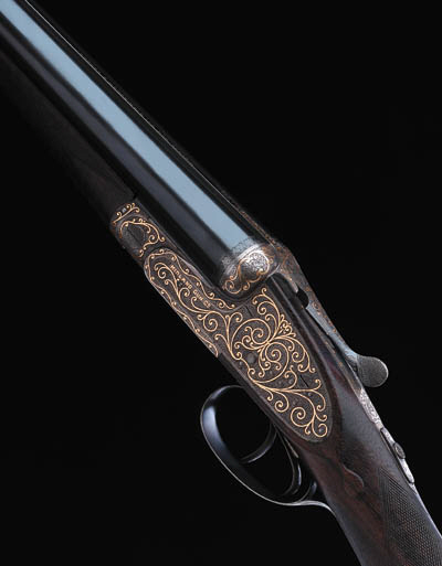AN UNUSUAL GOLD-INLAID 12-BORE