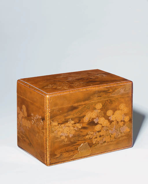 A rectangular gold lacquer box