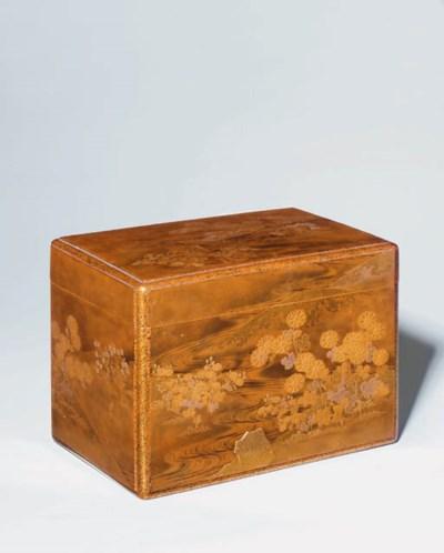 A rectangular gold lacquer box
