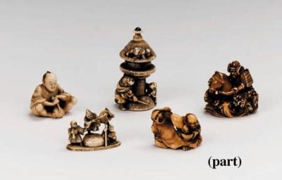A group of twenty-six wood and