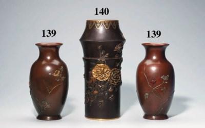 A cylindrical bronze vase