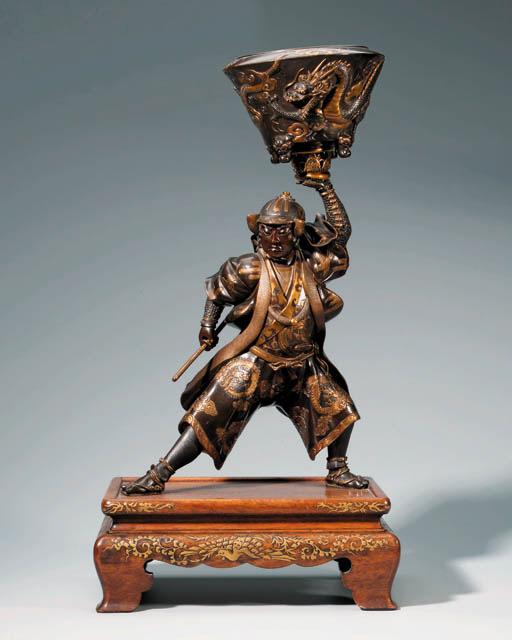 A Miyao bronze figure of Oishi