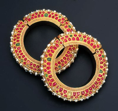 A PAIR OF MODERN GEM-SET BANGL