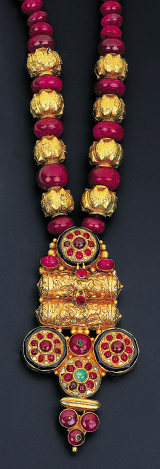 A MODERN RUBY BEAD AND GEM-SET