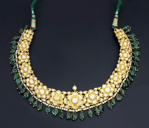 A DIAMOND, EMERALD AND ENAMEL