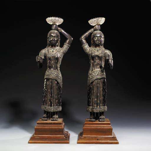 A PAIR OF INDIAN REPOUSS SILVE