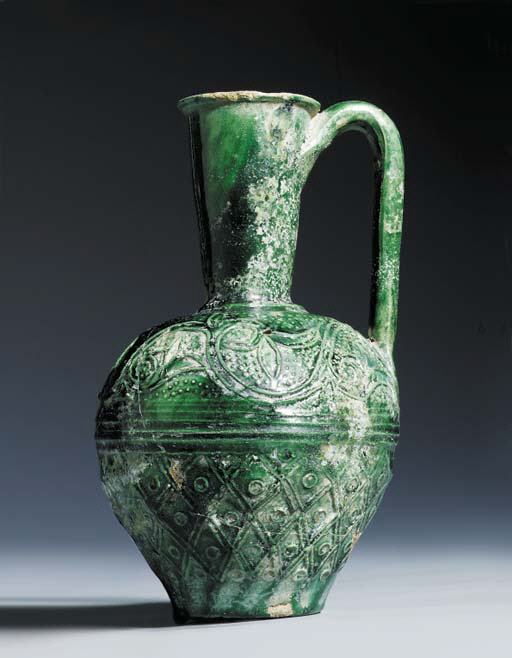 AN UMAYYAD GREEN GLAZED POTTER