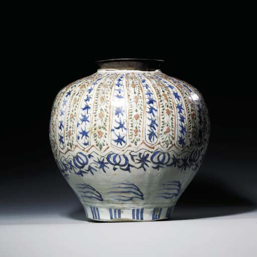 A KIRMAN POLYCHROME GLAZED LAR