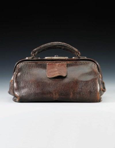 A cowhide kitbag belonging to