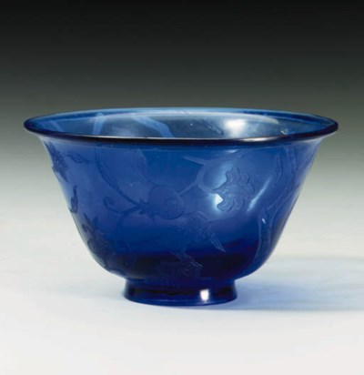 AN ENGRAVED BLUE GLASS BOWL