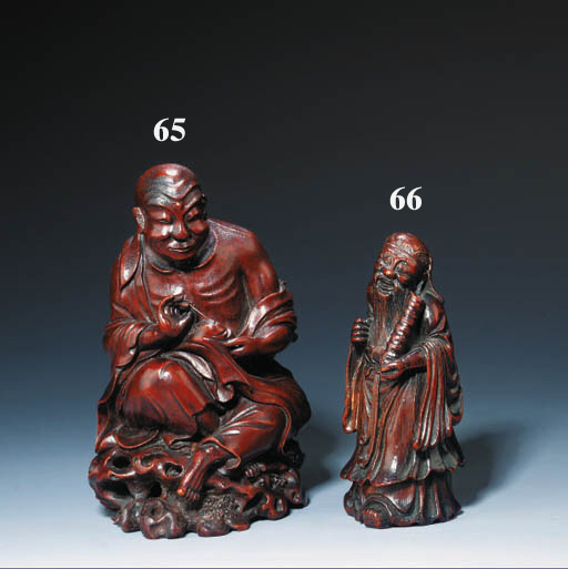 A WELL-CARVED BAMBOO FIGURE OF