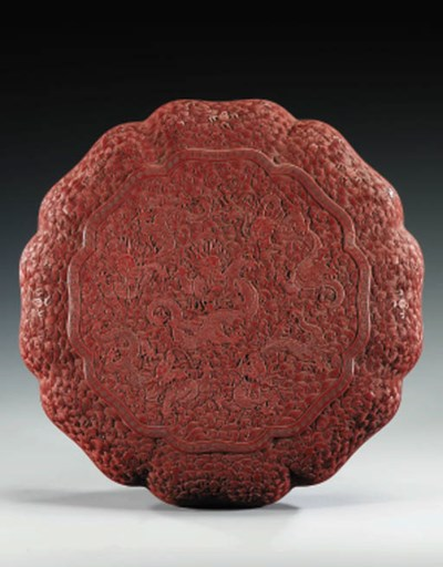A LARGE CARVED CINNABAR LACQUE