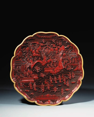 A CARVED RED LAQUER DISH